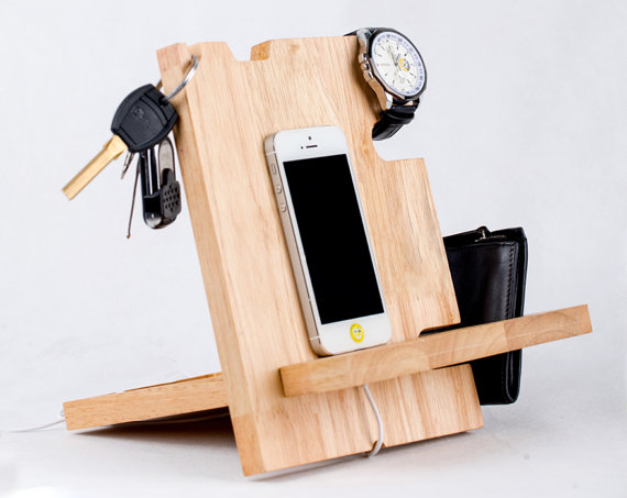 We love this all in one wooden docking station for all of your man's needs!