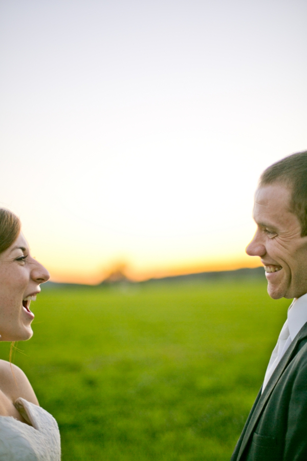 Gorgeous shot of the bride and groom laughing with each other!