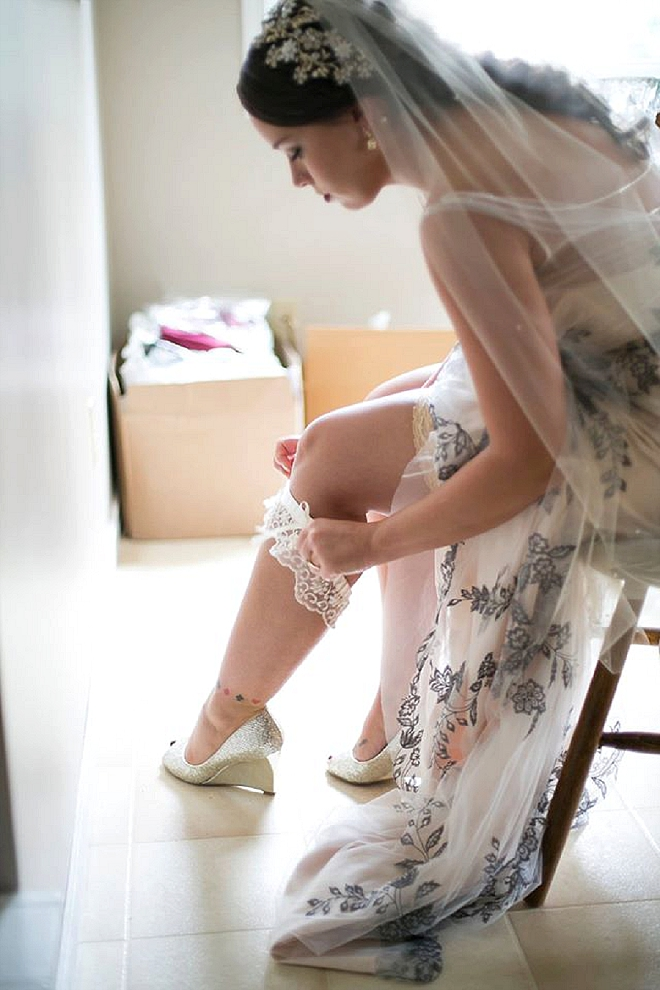 We love this snap of the Bride putting on her garter for the big day!