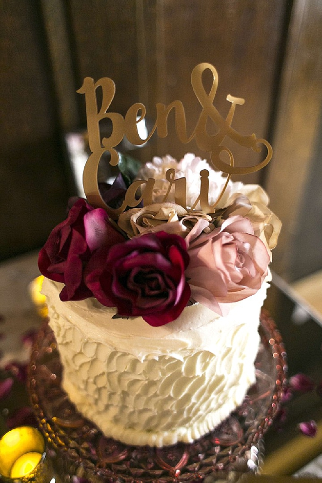 We're loving this darling cut cake and gold cake topper!