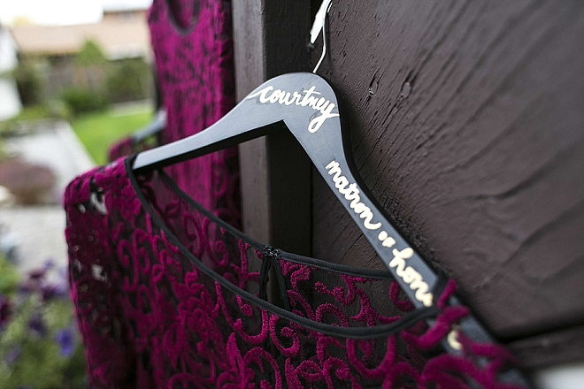 Loving the handmade dress hangers the Bride DIY'd!