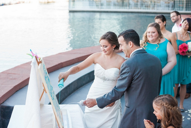 The Bride and Groom painting their keepsake ceremony canvas during the ceremony!