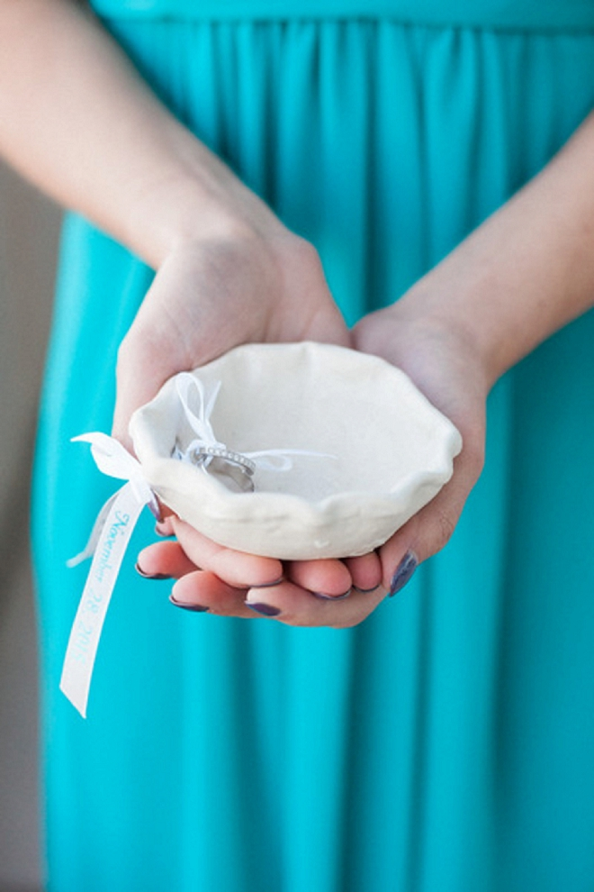We love this handmade ring bowl made by the Groom's Father!