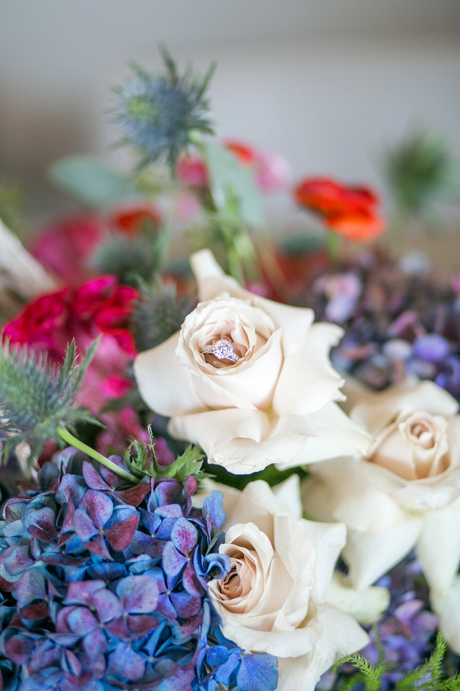 Check out this gorgeous ring shot in the bride's stunning bouquet!