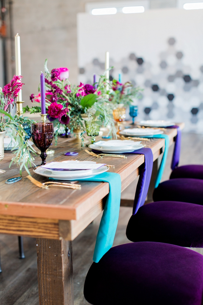 The gold and jewel toned place settings at this styled wedding are so gorgeous!
