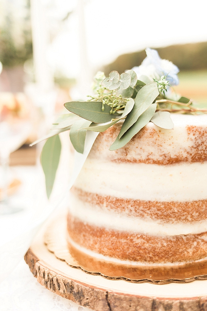 Loving this stunning naked cut cake at this styled wedding!