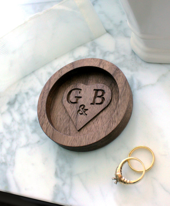 We love this beautiful hand carved wooden engagement ring dish!