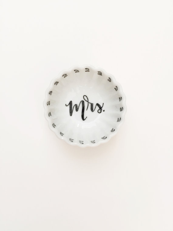 We are swooning over this stunning simplistic Mrs. engagement ring dish!
