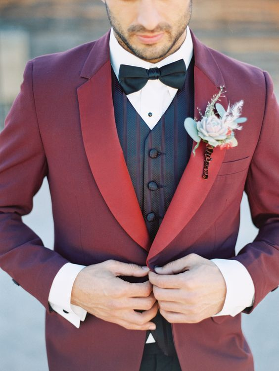 We LOVE this Groom's deep burgundy red tux!