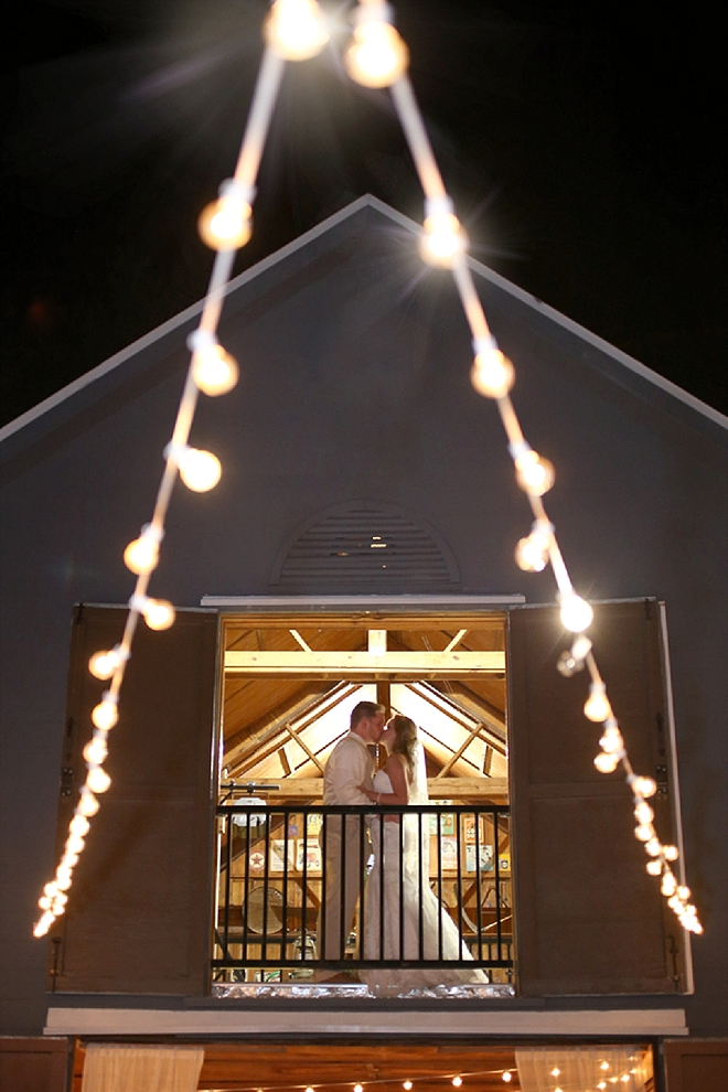 We're crushing on this twinkle lit barn reception!