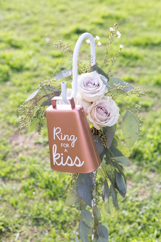 You have to see this adorable DIY ring for a kiss cowbell, perfect for a garden wedding!