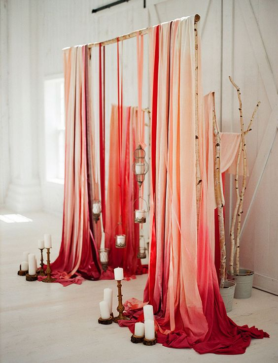 Check out this AMAZING red ombre ceremony backdrop!