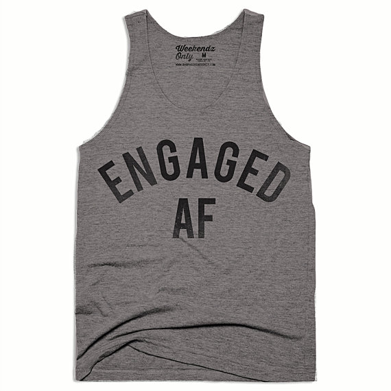 Show off your newly engaged status with this cute Engaged AF tank!