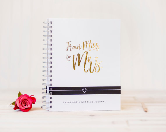 We're crushing on this gorgeous Miss to Mrs wedding planning journal!