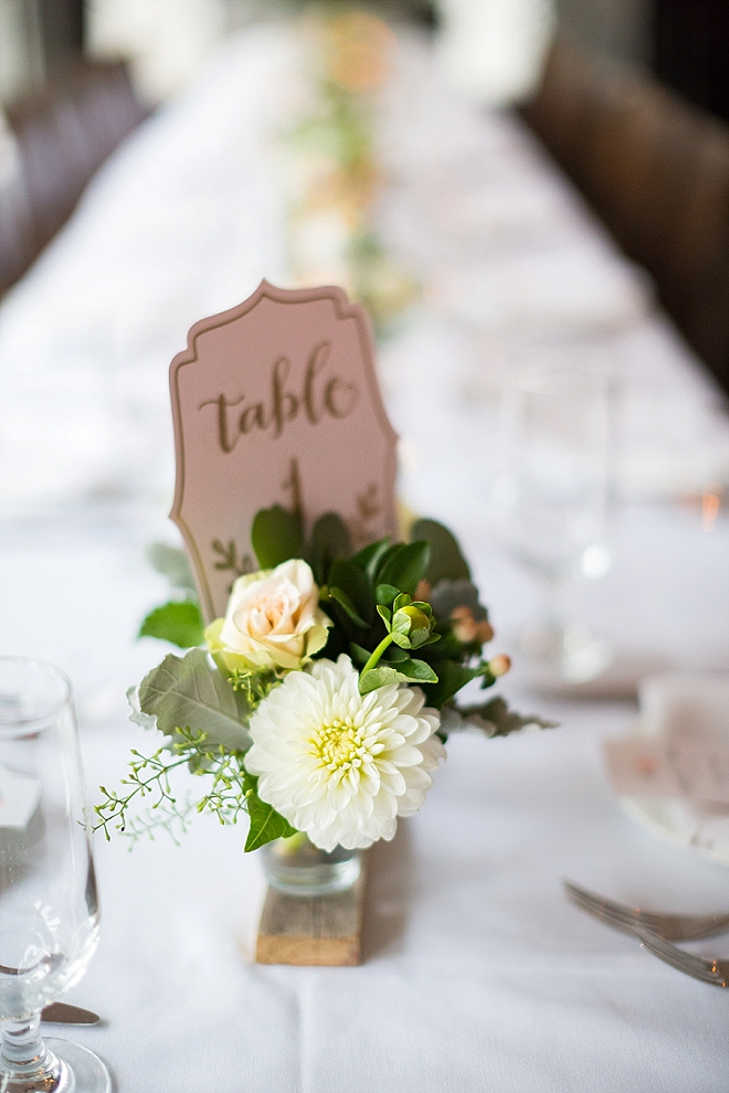 Love this couple's stunning handmade centerpieces and table numbers!
