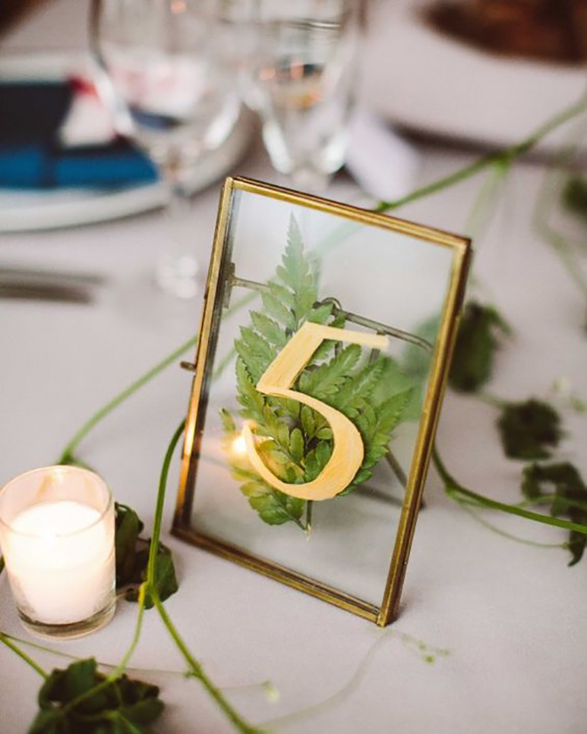 A pressed leaf table number is a great DIY idea.