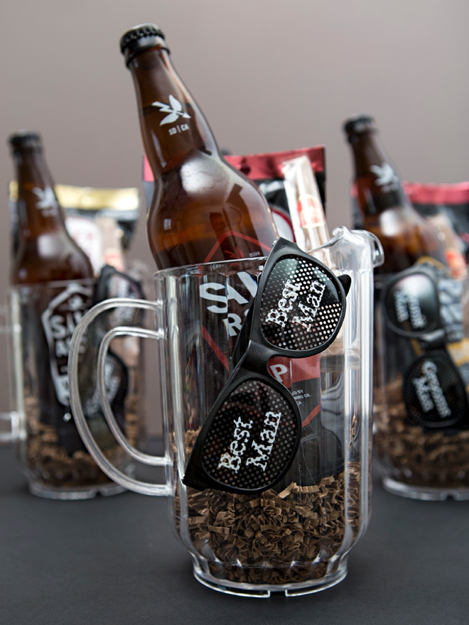 Give your groomsmen their gifts in a large beer pitcher, so fun!
