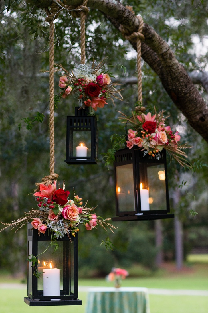 Love these lanterns combined with flowers for our spring wedding.