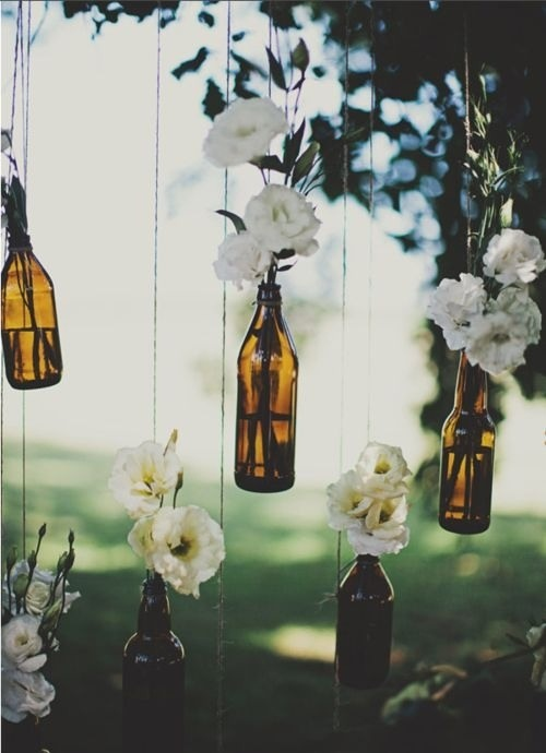 Wine bottles and flowers - awesome idea for an easy backyard wedding.