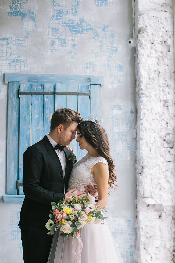 Gorgeous shot of a groom holding his bride!