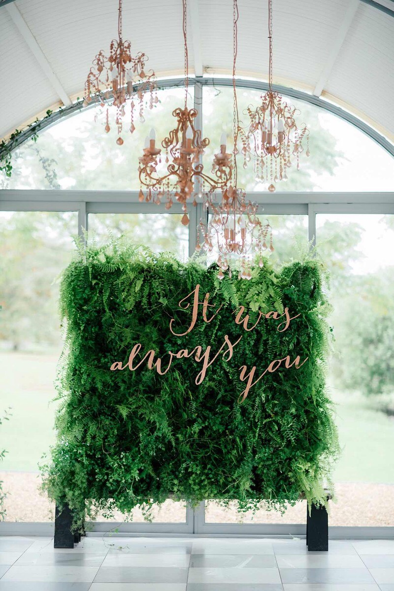 It was always you sign, hung on an amazing wall of greenery!