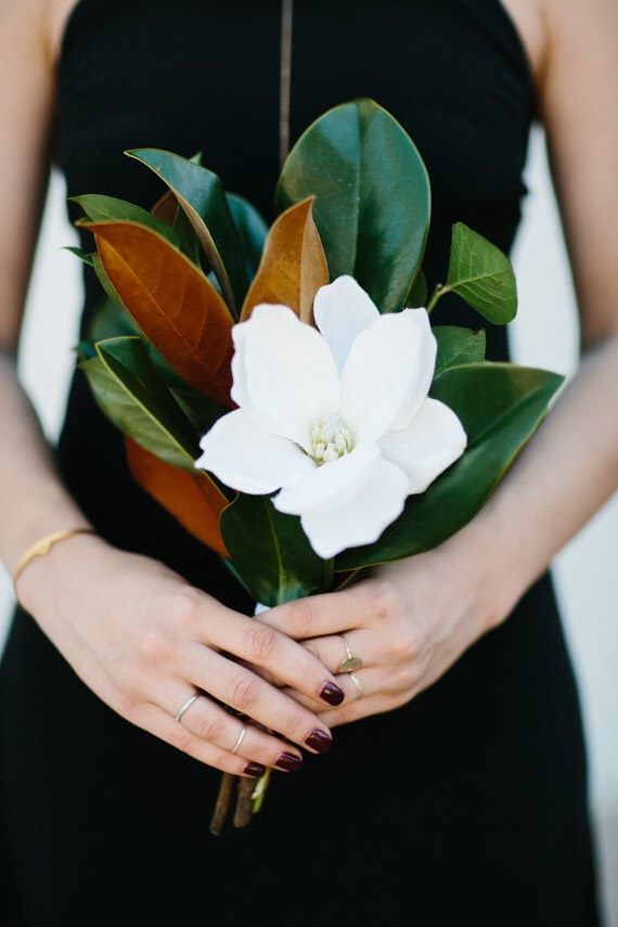 Stunning magnolia leaf bouquet with single white flower