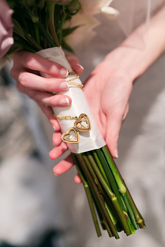 We love that this Bride wrapped her bouquet with her Grandmother's locket - so sweet!
