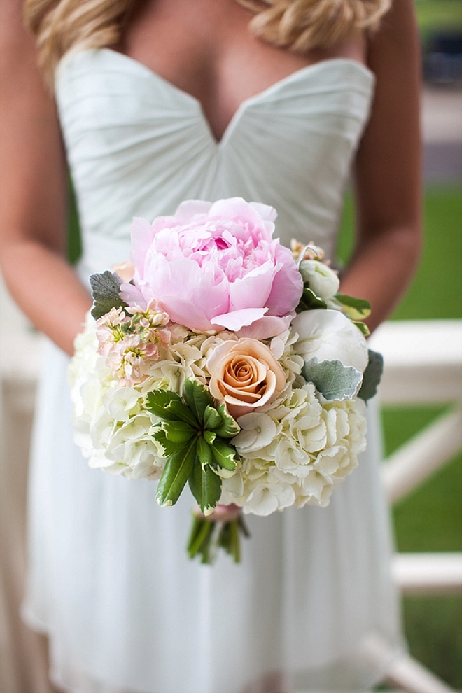 We love this snap of this Bridesmaid and her gorgeous bouquet!