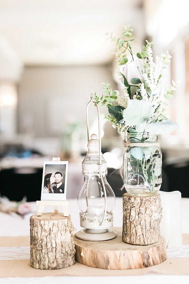 We are loving these rustic-chic wooden centerpieces at this gorgeous reception!
