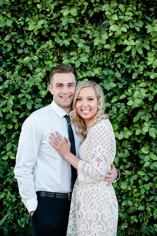 There's nothing more gorgeous than a couple in love in front of a gorgeous greenery wall!