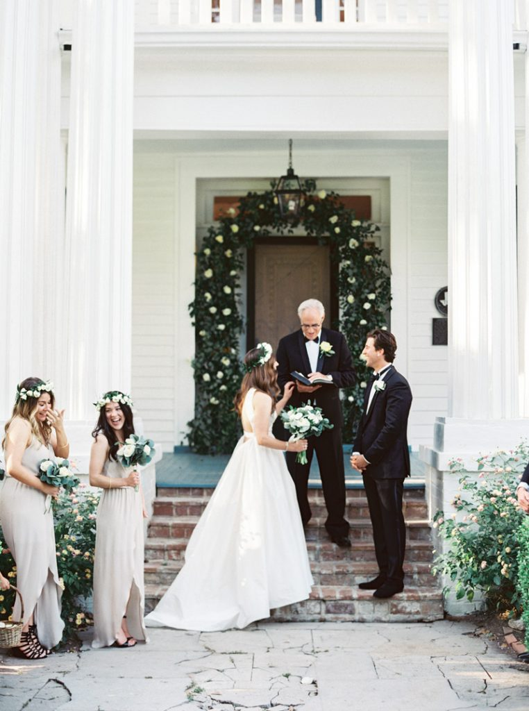 Pretty floral crowns, white flowers, and neutral bridesmaid dresses.