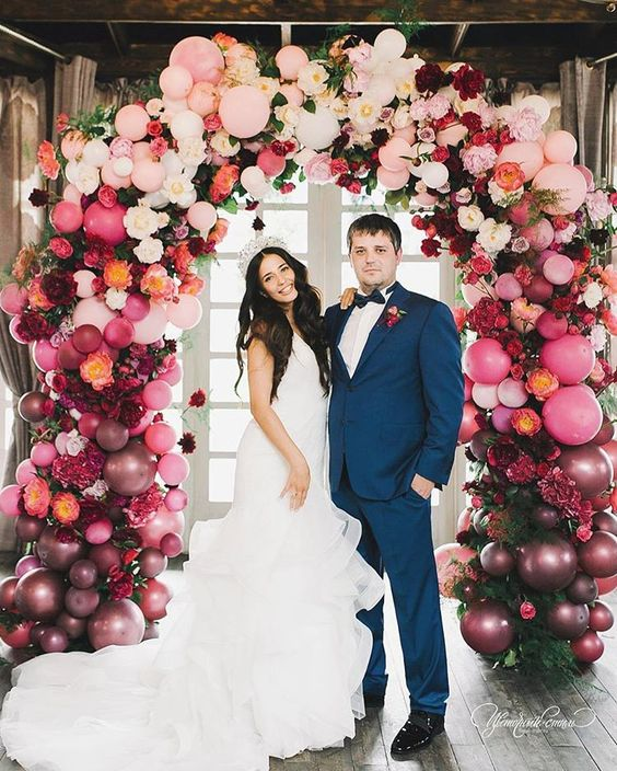 OMG this wedding balloon arch is INSANE! Love the jewel tones and the gorgeous bride.
