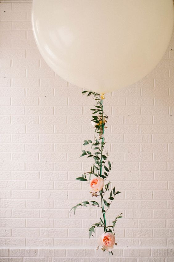 Floral balloon garland - so pretty and feminine. I could see this at a party or wedding!
