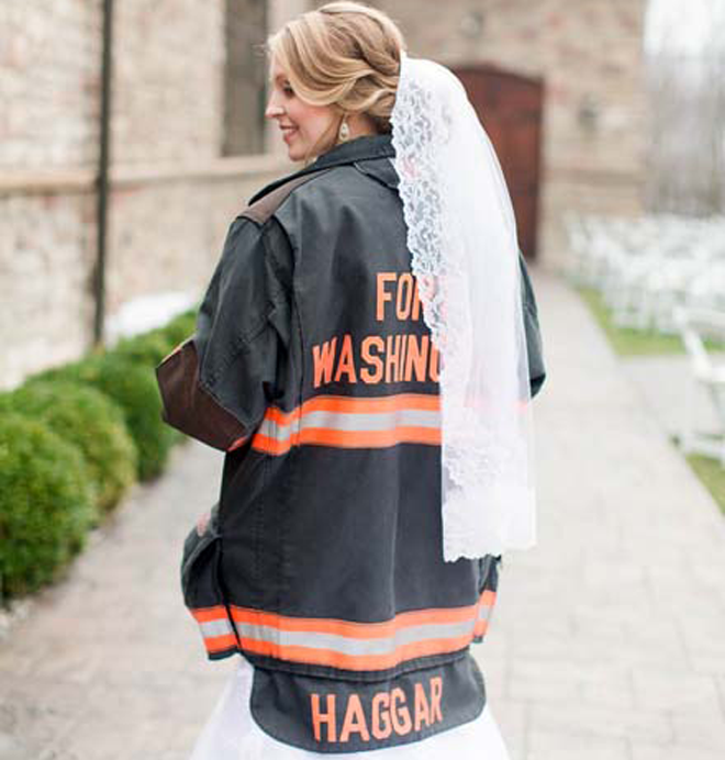 How darling is this Bride in her hubby's fireman jacket?! LOVE!