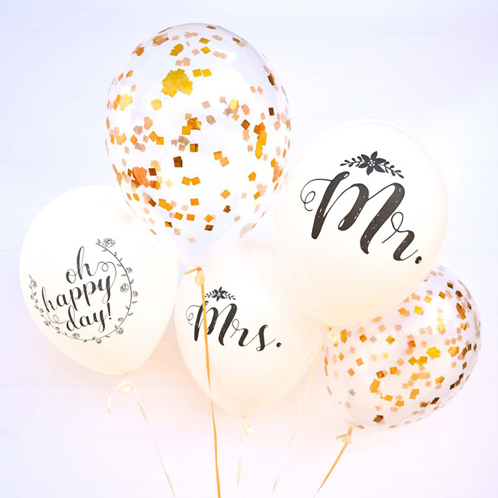 Mr and Mrs balloons with gold confetti balloons.  Wedding decoration idea?