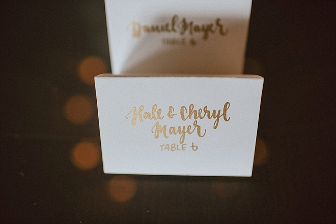 Loving these hand lettered gold place cards!