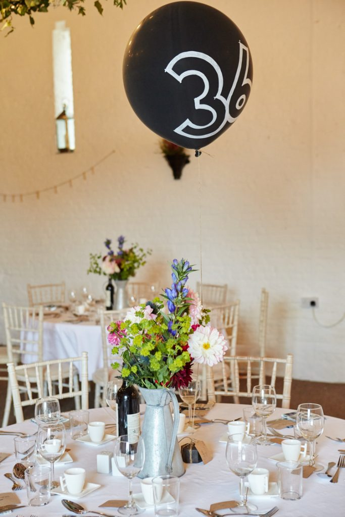 Such a unique wedding idea! Table numbers made out of balloons. #diy