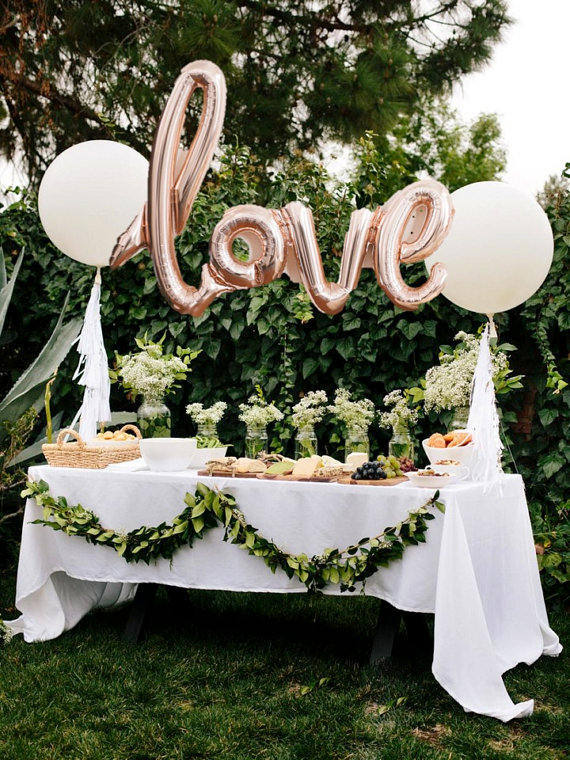 Love letter balloons.  Such a cute way to spice up a food or dessert table at a wedding.