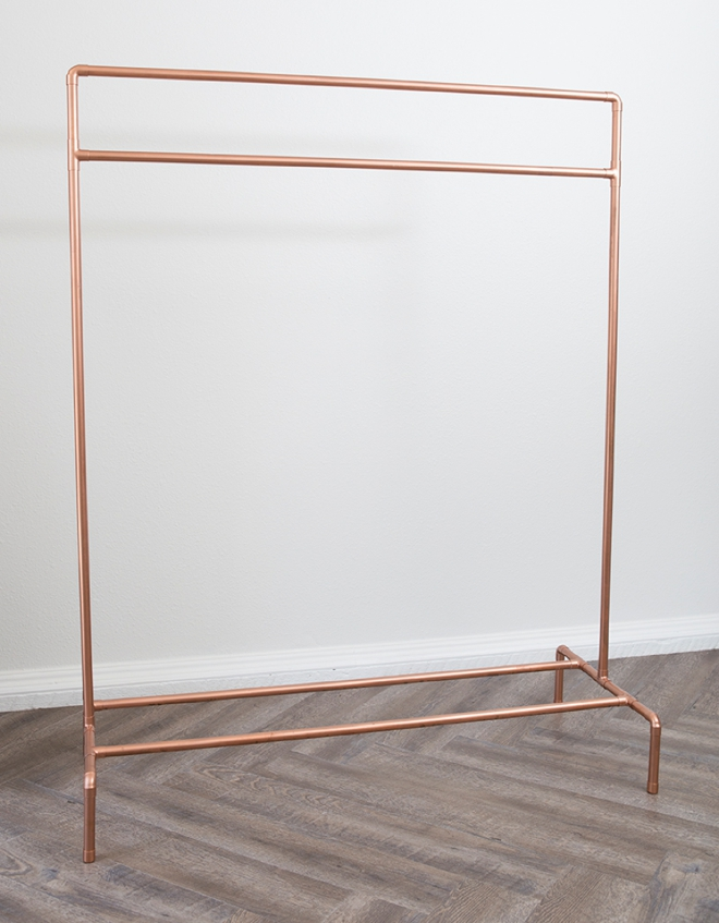 This DIY copper pipe wardrobe stand is AMAZING