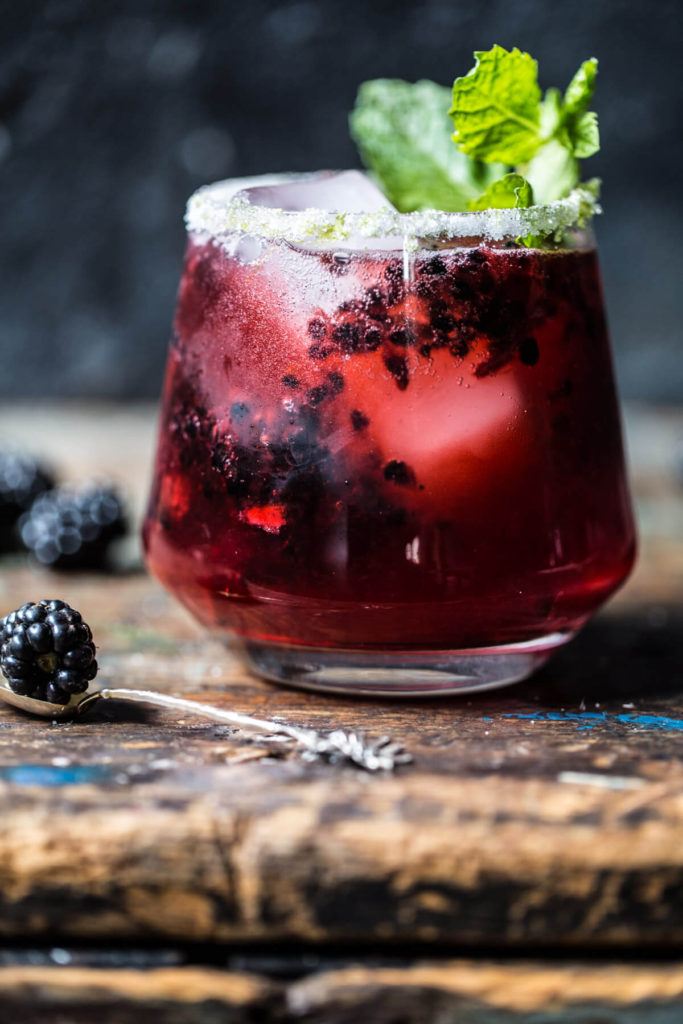 This blackberry bourbon smash is a great spooky halloween or fall wedding drink.