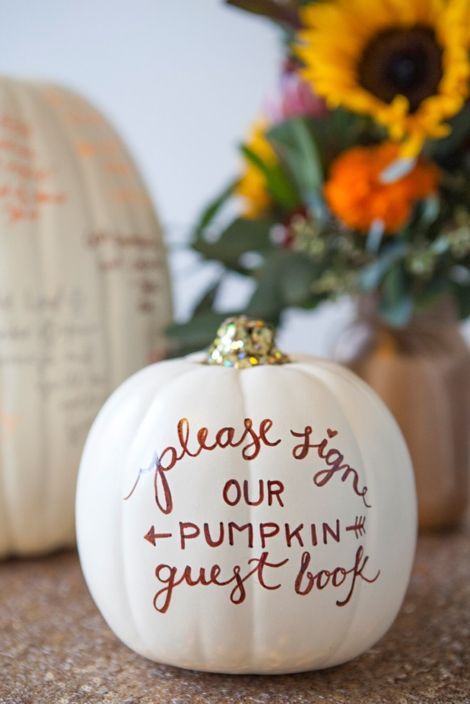 Such a cute idea for a fall or halloween wedding! This white pumpkin and glitter guest book is such a cute memory.