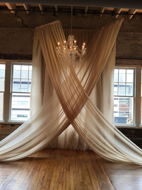 Chic and classy wedding fabric draping with a chandelier.