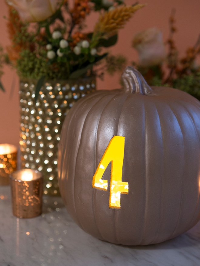 These DIY faux pumpkin table numbers would be perfect for a fall wedding!