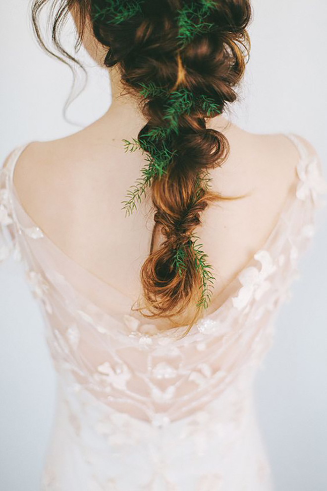 Try adding in some winter greenery to your braid.