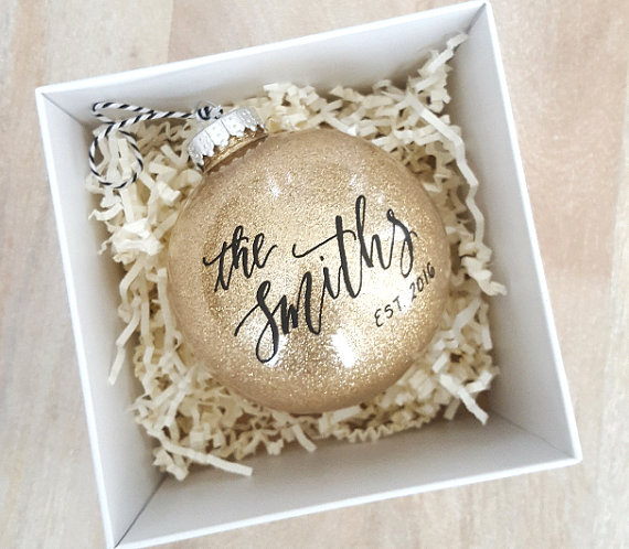 In LOVE with this glittery gold personalized Christmas ornament! Perfect for the newlywed in your life!