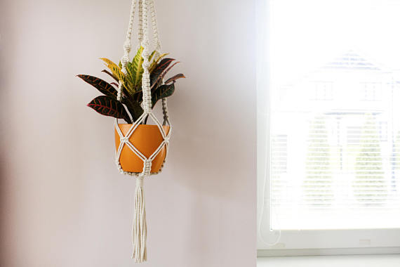 This macrame plant holder will lighten your home up!