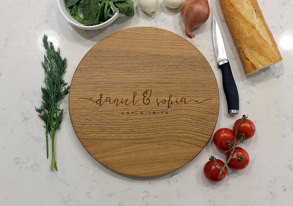Everyone needs this gorgeous round monogrammed cutting board!