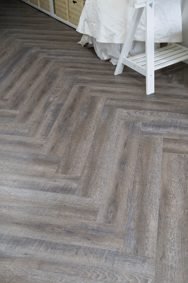 This herringbone peel and stick floor is amazing!