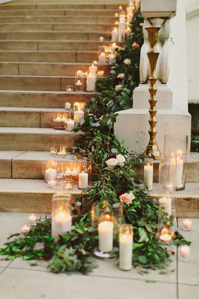 Candles and greenery are the perfect combination for a holiday wedding.