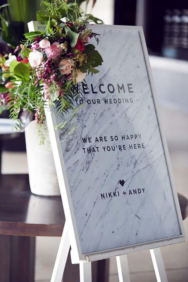 A marble welcome sign sets the scene for a beautiful reception.